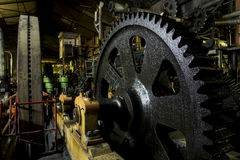Huge cog wheel in industrial hall Royalty Free Stock Photos