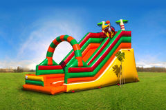 Huge colorful inflatable slide on the playground Stock Photography