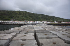 Huge concrete blocks in port of Lajes do Pico, Azores Stock Images
