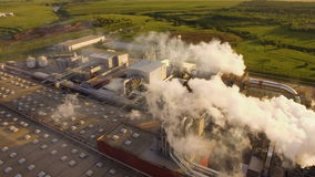 A huge concrete plant with pipes among the fields. aerial view. A huge concrete plant with pipes among the fields stock footage