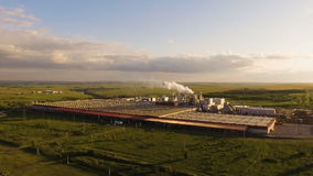 A huge concrete plant with pipes among the fields. aerial view. A huge concrete plant with pipes among the fields stock video footage