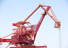 Huge construction crane against clear blue sky Stock Photo