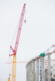 The huge construction site in the daytime. Crane Royalty Free Stock Images