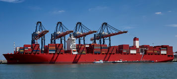 Huge container ship in Rotterdam harbour Royalty Free Stock Photos