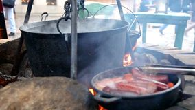 Huge copper cauldron with the tasty mulled wine stock footage