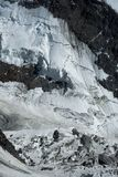 Fragment of mountain and glacier. Huge cracks in the glacier on mont blanc. A lot of ice, rocks and stones royalty free stock photo