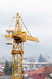 Huge crane in front of houses Royalty Free Stock Photography