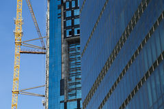 Huge crane rising near construction of a skyscraper against blue sky in Istanbul Royalty Free Stock Photography