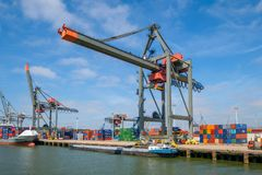 Huge crane for sea containers in Rotterdam harbour. stock image