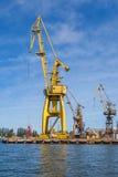 Huge cranes on the quay shipyard Stock Photos