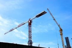 Huge  cranes working. Home construction. Stock Photo