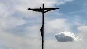The huge Cross with clouds background at the Sanctuary of Fatima, Portugal royalty free stock photo