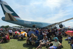 Huge crowd enjoys the airshow at EAA AirVenture. A huge crowd surrounds a 747 while watching the airshow at the 2016 EAA AirVenture in Oshkosh, Wisconsin stock images