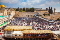 The huge crowd for a prayer. The huge crowd of Jews for a prayer has gathered on the square. Western Wall of the Temple. Autumn holiday of Sukkot in Jerusalem Stock Images