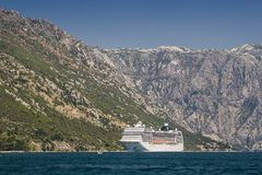 Huge cruise liner ship in port of Kotor city, Montenegro.  stock photo