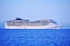 Huge cruise ship. On a background of blue sea Royalty Free Stock Photo