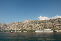 Huge cruise ship in the Bay of Kotor in Montenegro. A beautiful. Country to travel royalty free stock photo