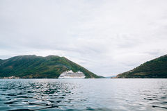 Huge cruise ship in the Bay of Kotor in Montenegro. A beautiful. Country to travel stock photography