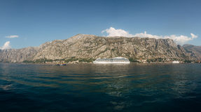 Huge cruise ship in the Bay of Kotor in Montenegro. A beautiful. Country to travel royalty free stock photography