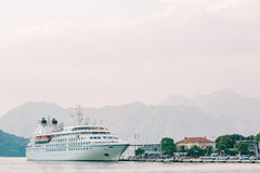 Huge cruise ship in the Bay of Kotor in Montenegro. Near the old. Town of Kotor. A beautiful country to travel stock photo