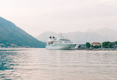 Huge cruise ship in the Bay of Kotor in Montenegro. Near the old. Town of Kotor. A beautiful country to travel stock photography