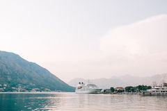 Huge cruise ship in the Bay of Kotor in Montenegro. Near the old. Town of Kotor. A beautiful country to travel royalty free stock photo