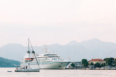 Huge cruise ship in the Bay of Kotor in Montenegro. Near the old. Town of Kotor. A beautiful country to travel royalty free stock image