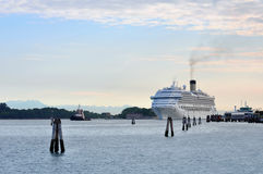 Huge cruise ship docking in the bay at Lido Island. Large white cruise ship preparing to dock in the bay off Lido Island, Venice royalty free stock photos