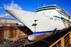Huge cruise ship at dry dock Stock Images