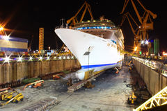Huge cruise ship at dry dock Stock Photos