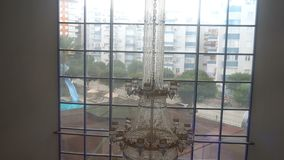 A huge crystal chandelier in the hotel,the view from the Elevator.  stock footage