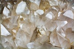 Huge crystal of colorless gemstone quarts, geology mineral background. Close up stock photography