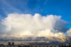 Huge cumulonimbus cloud over the city, in the evening. Royalty Free Stock Images