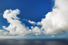 Huge cumulus cloud hovering over ocean Royalty Free Stock Image