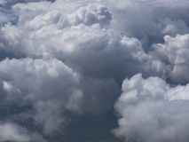 Huge cumulus clouds high in stratosphere. Huge cumulus clouds high in the stratosphere Royalty Free Stock Images