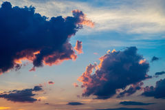 Huge cumulus clouds at sunset Stock Images