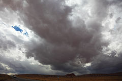 A huge dark cloud on the road Royalty Free Stock Images