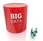 Huge database symbol dwarfs three people - big data concept Royalty Free Stock Photo