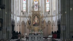 Huge decorated altar in gothic catholic church. No people in daytime stock video