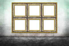 Huge decorated frame on dirty wall Royalty Free Stock Photo