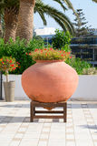 Huge decorative pot with flowers Stock Photos