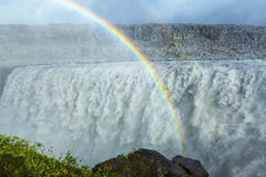Huge Dettifoss waterfall with a double rainbow, Iceland. Huge Dettifoss waterfall with big double rainbow, Iceland Stock Photography