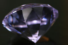 Huge diamond. A clear purple diamond on black Royalty Free Stock Image