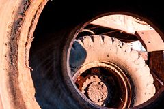 Huge dirty car wheels kind of inside Royalty Free Stock Photography