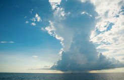 Huge distant cloud with rain over the sea Stock Photo