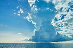 Huge distant cloud with rain over the sea Royalty Free Stock Photo