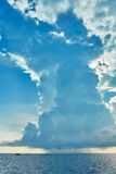 Huge distant cloud with rain over the sea Royalty Free Stock Images