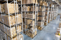 Huge distribution warehouse with high shelves Royalty Free Stock Photography