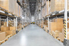 Huge distribution warehouse with high shelves Stock Images