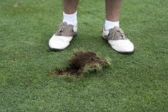 A huge divot. A golfer looking over his huge divot Royalty Free Stock Photo